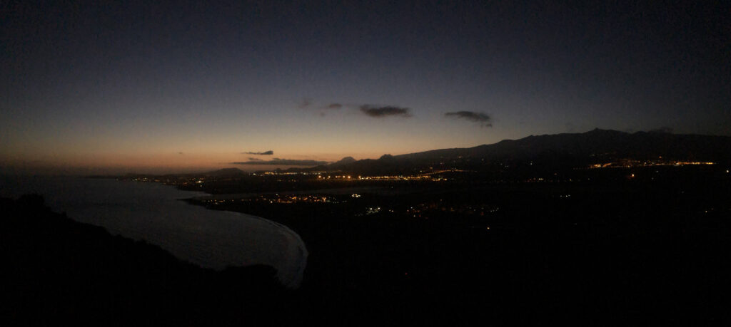 A panorama of Tenerife in the dark as seen from the top of the Montaña Roja.