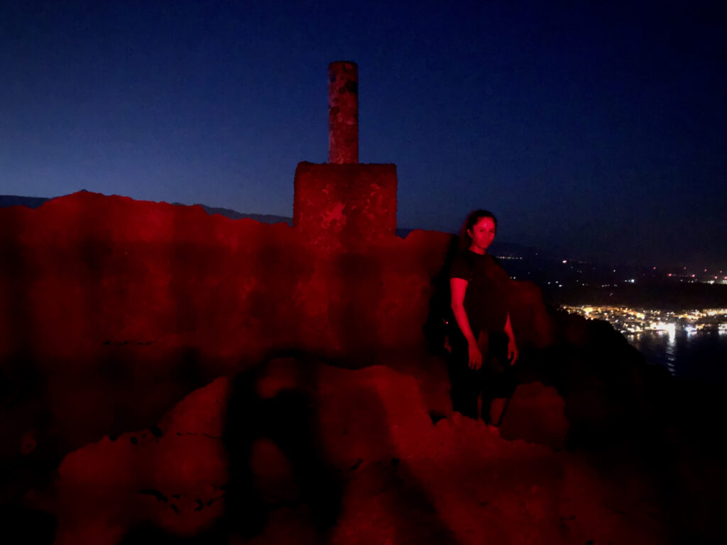 Cami is illuminated in red atop the red mountain in Tenerife.