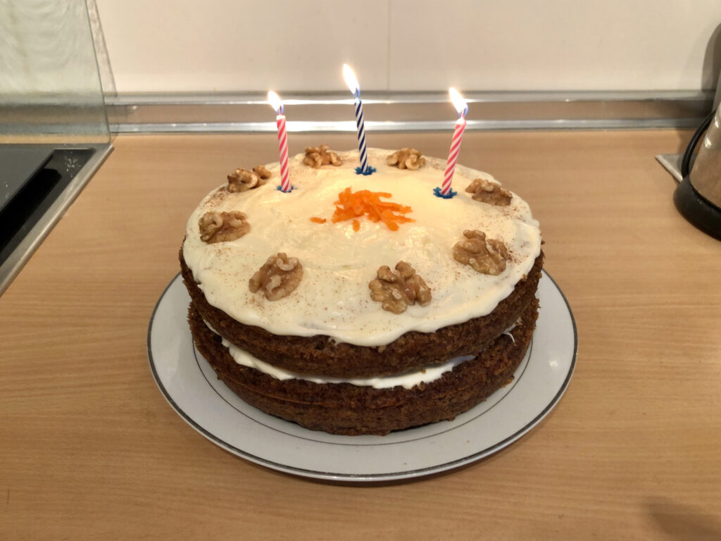 A carrot cake with candles.