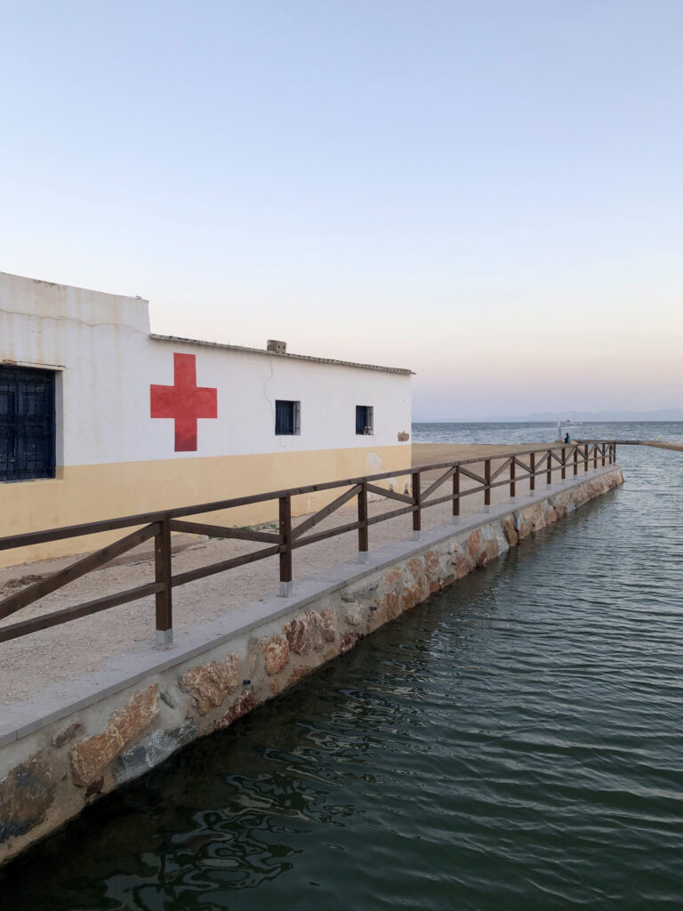 A first-aid building jutting out into the sea.