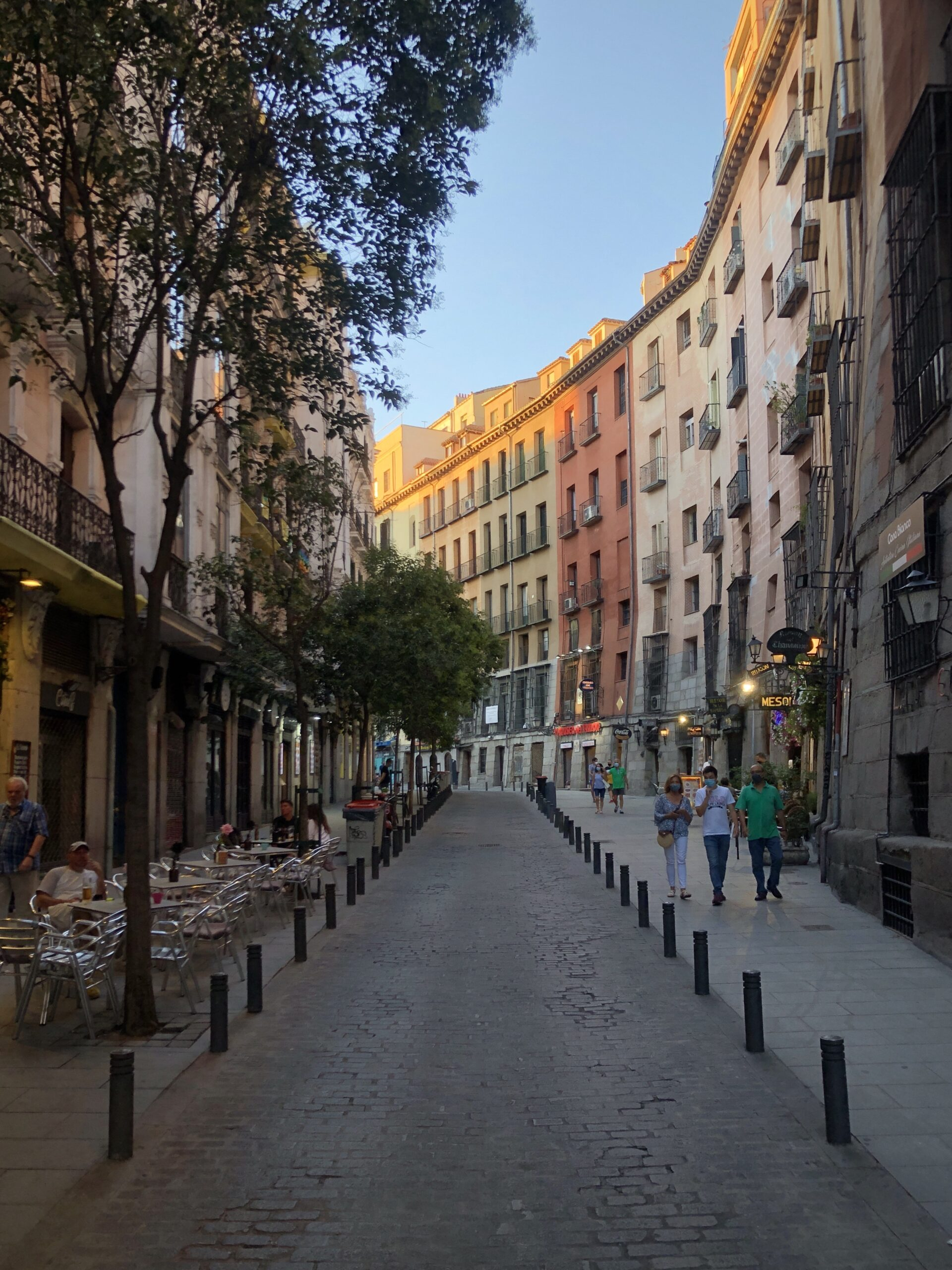 A street in the ancient part of Madrid, lit in the warm sun of an evening.