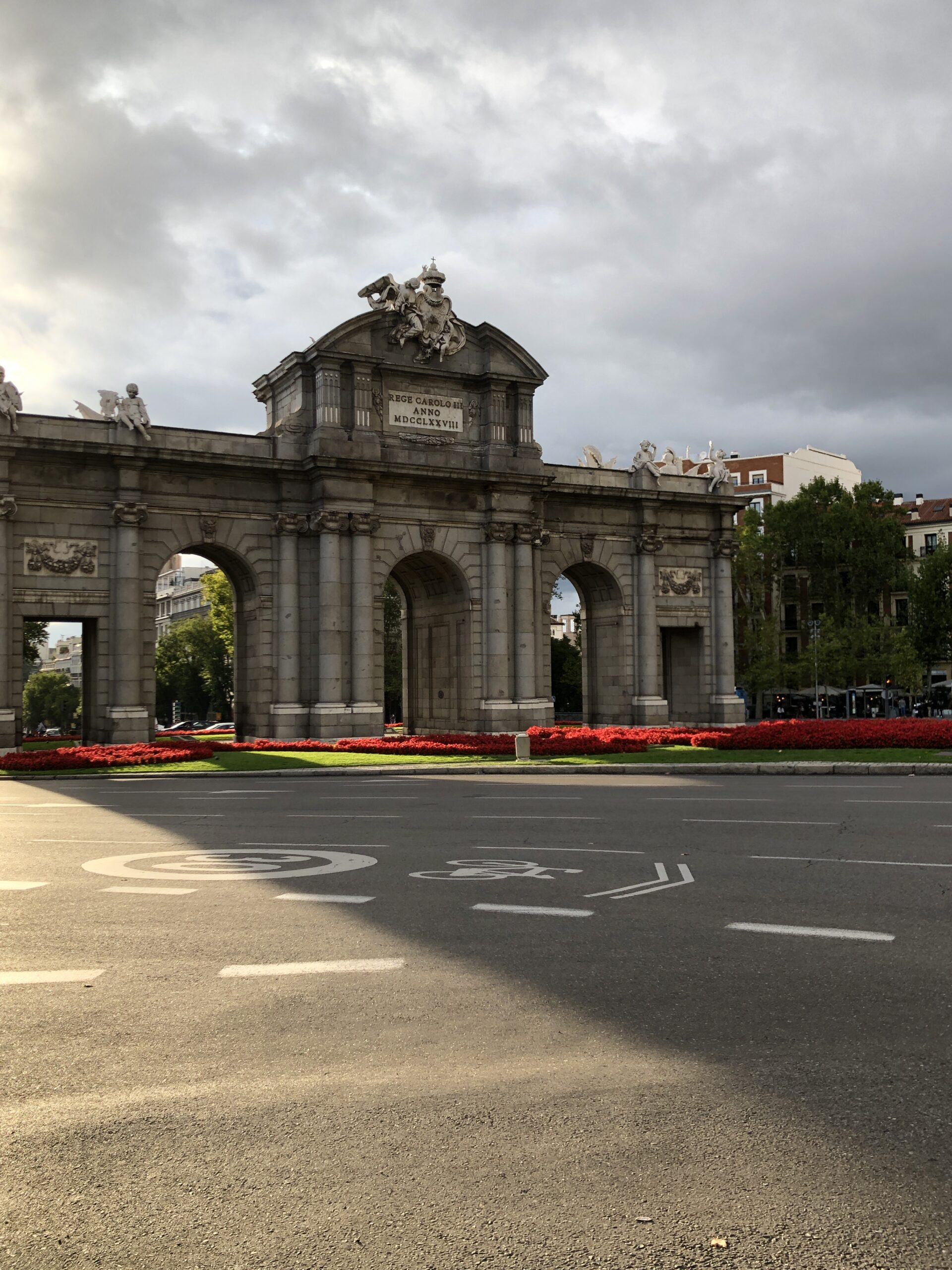 The Puerta de Alcalá in Madrid in the sunlight.